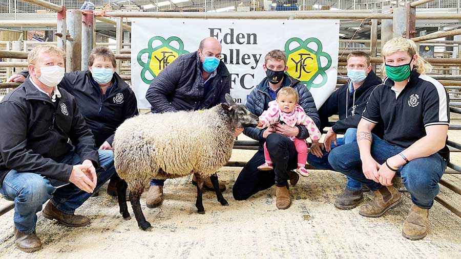 Hywel Williams with Hywel Blue Texel with Eden Valley YFC members, Ben Richardson and daughter Millie