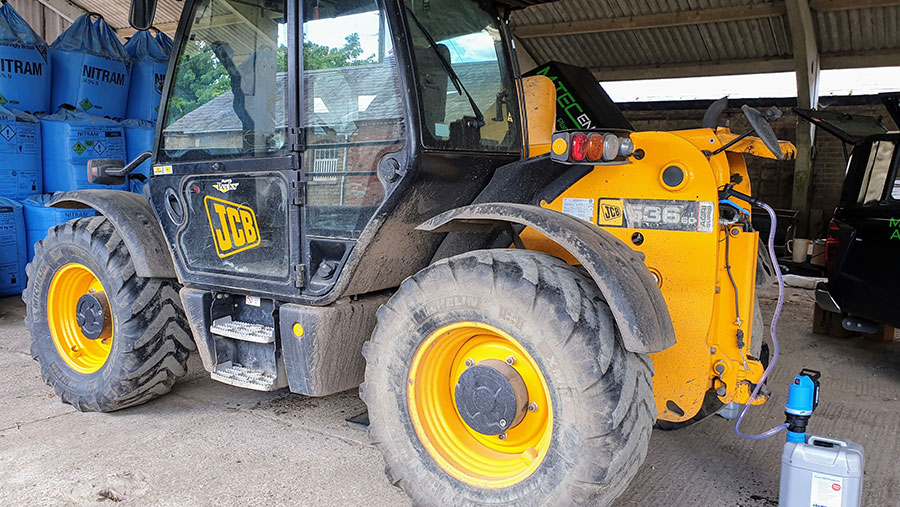 JCB being filled with oil