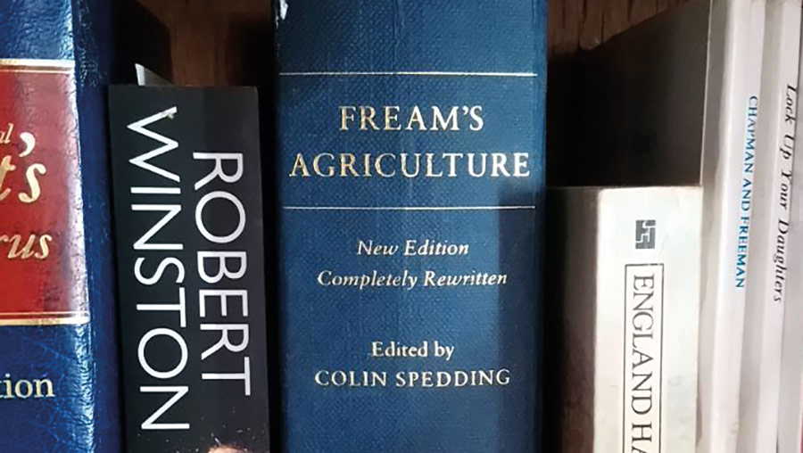 Books on a bookshelf, including Fream's Agriculture