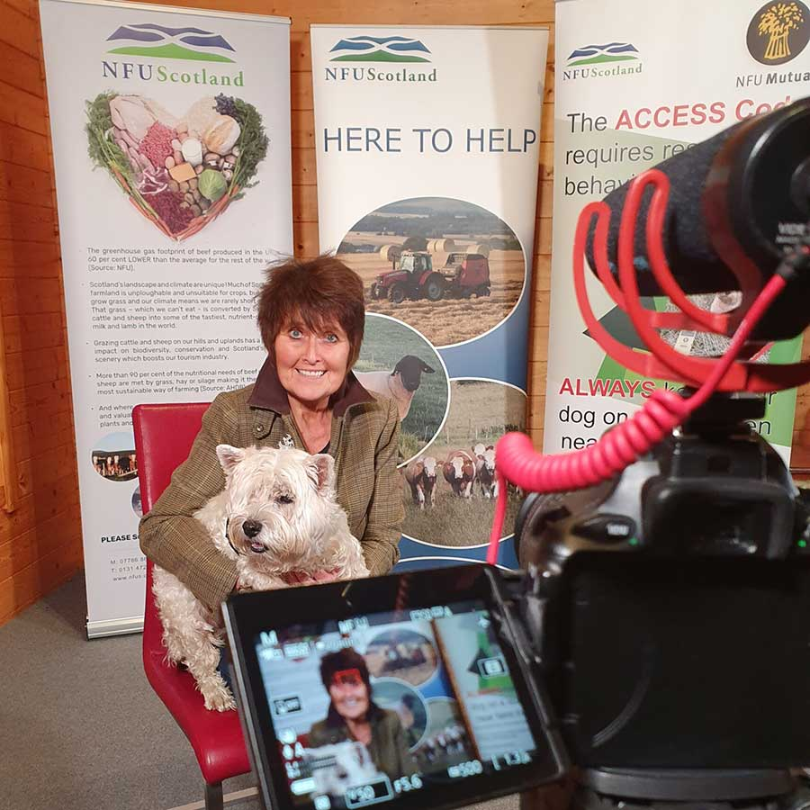 Lorna Paterson with dog Fegie in front of camera