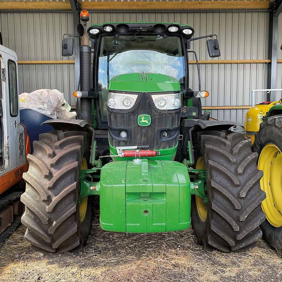 John Deere 6150R tractor in a shed