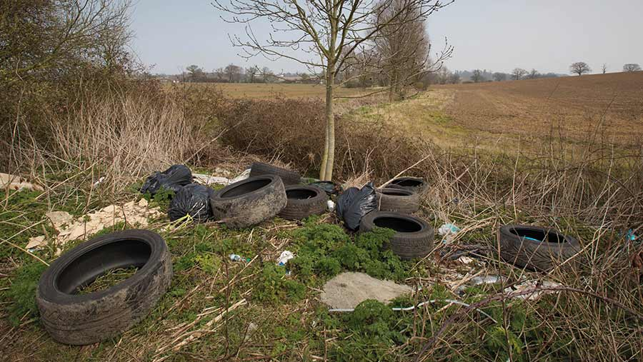 tyres and rubbish dumped in farm gateway