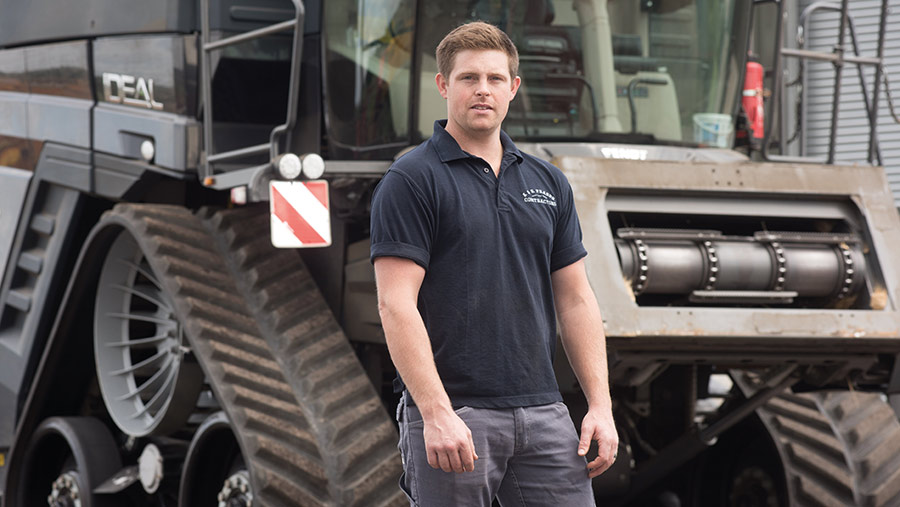 George Fraser in front of tractor