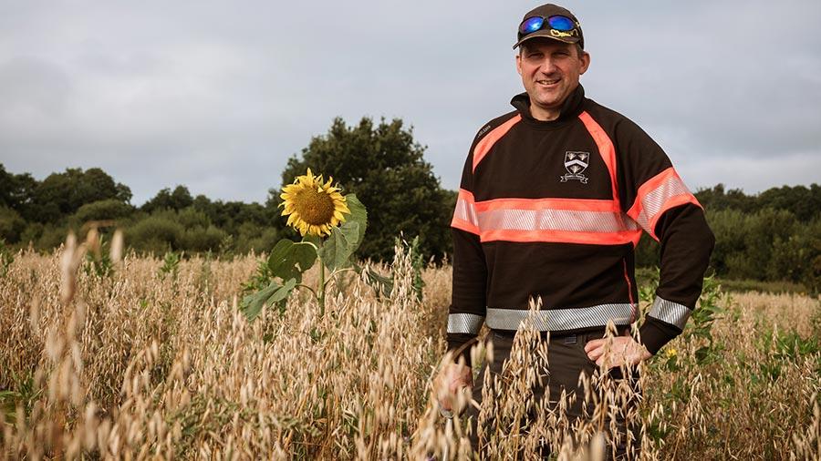 Tom Sewell in Warnhams Farm oat crop