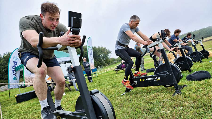 Britain's Fittest Farmer competitors on exercise bikes