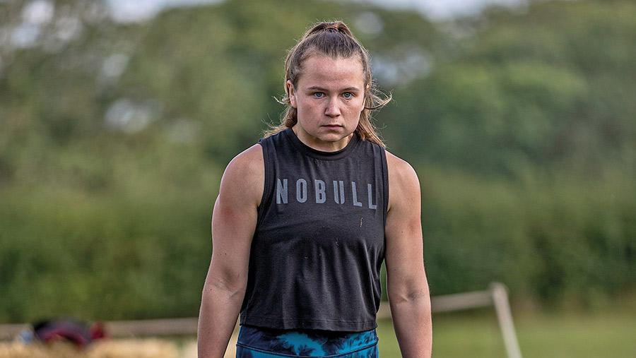 Heidi Wilson lifting a weight