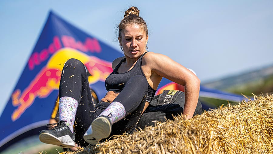 Laura Pollock on a haybale