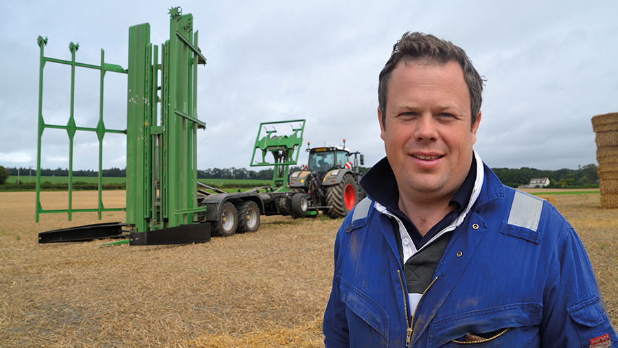 Peter Williams in field with bale chaser