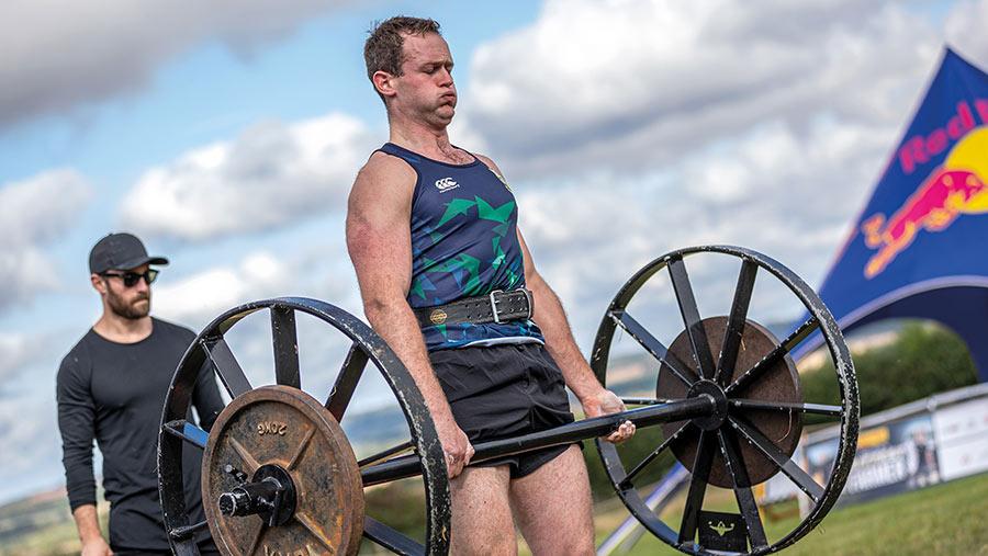 John Carlisle lifting weights