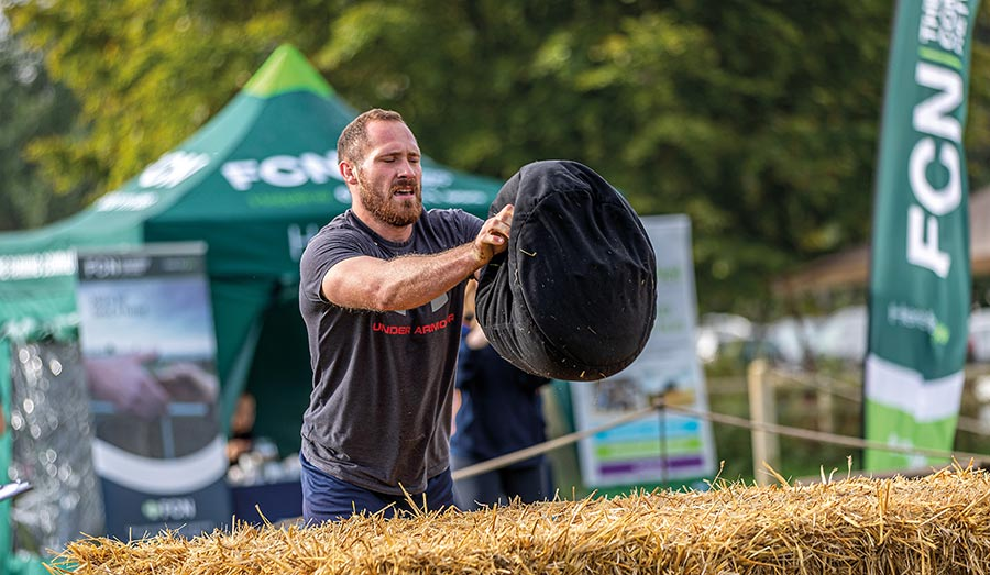 Tim Wilcox lifting weights
