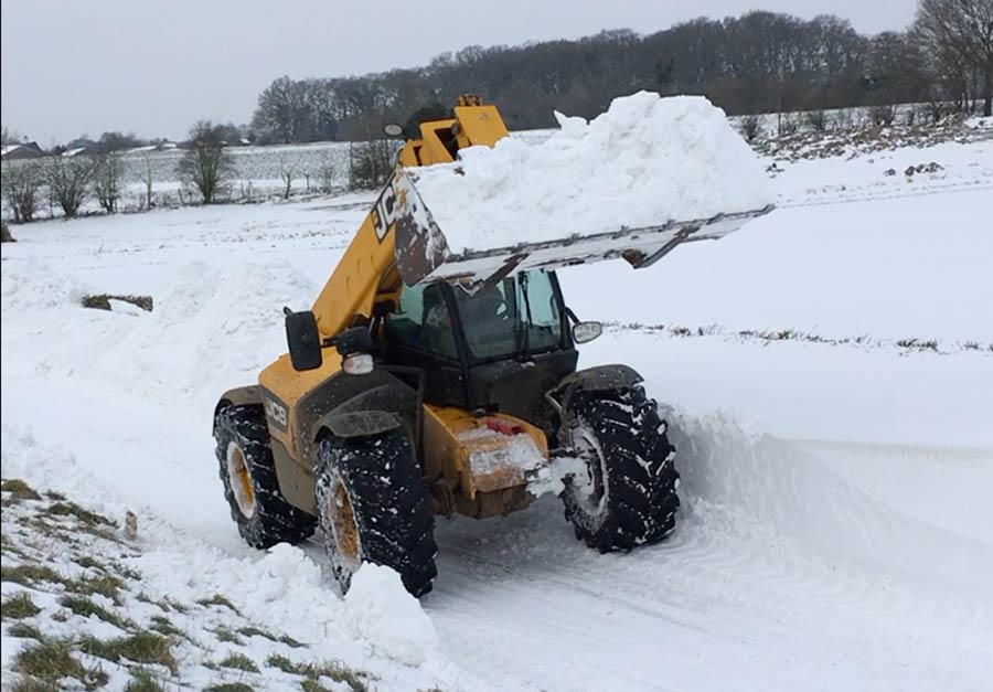 JCB clearing snow