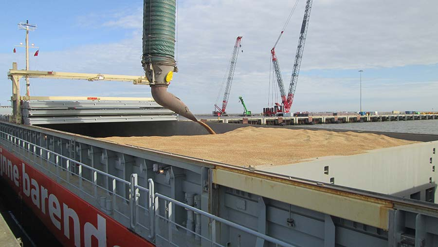 Grain being poured into grain ship