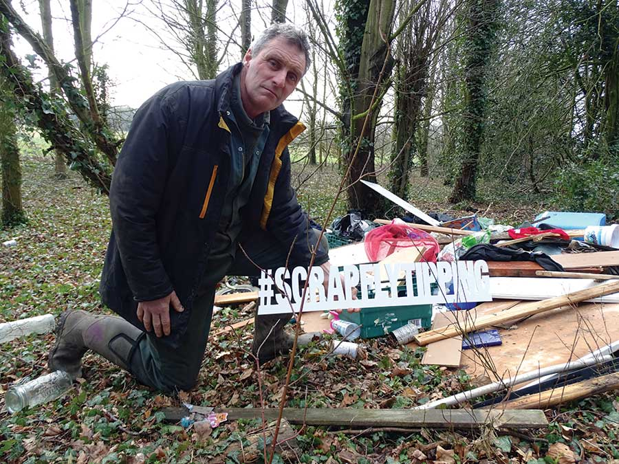 Will Dickinson with a pile of fly-tipped rubbish