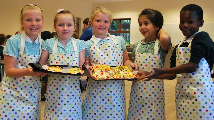 School children cooking at Barleylands