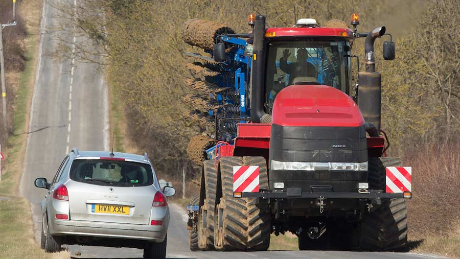 Case Quadtrac 450 passing car on narrow road