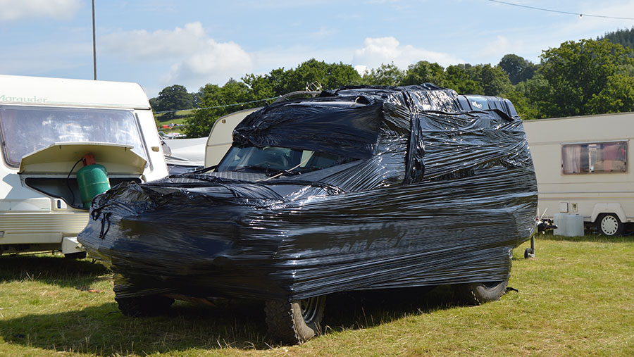 A Land Rover wrapped in plastic