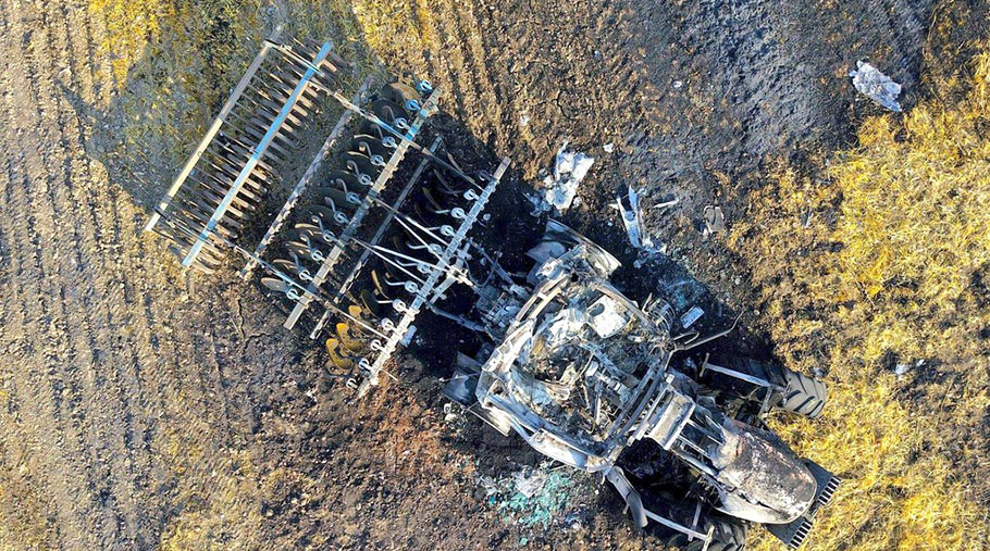 An aerial view of a burned out tractor