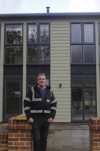 William Ashley standing outside his barn conversion