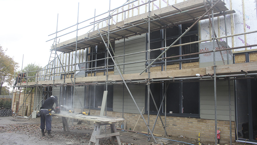 Construction work being undertaken on one of the farm barns