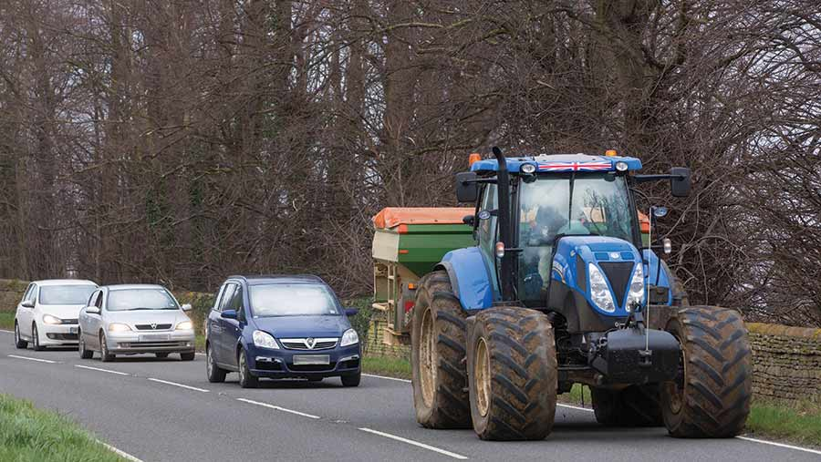 Queue of cars behind a tractor on the road