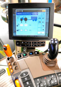 John Deere cab showing central tyre inflation controls