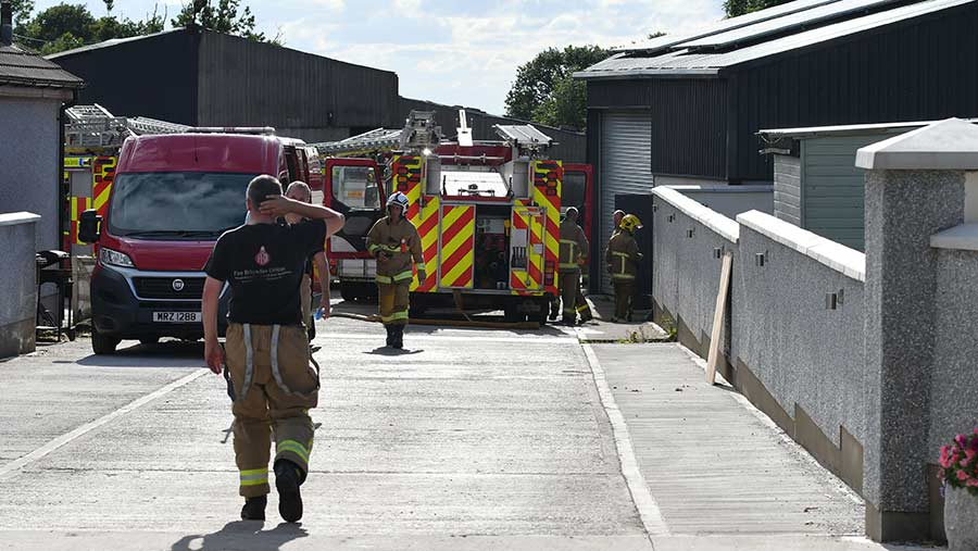 Firefighters and fire engines on farm