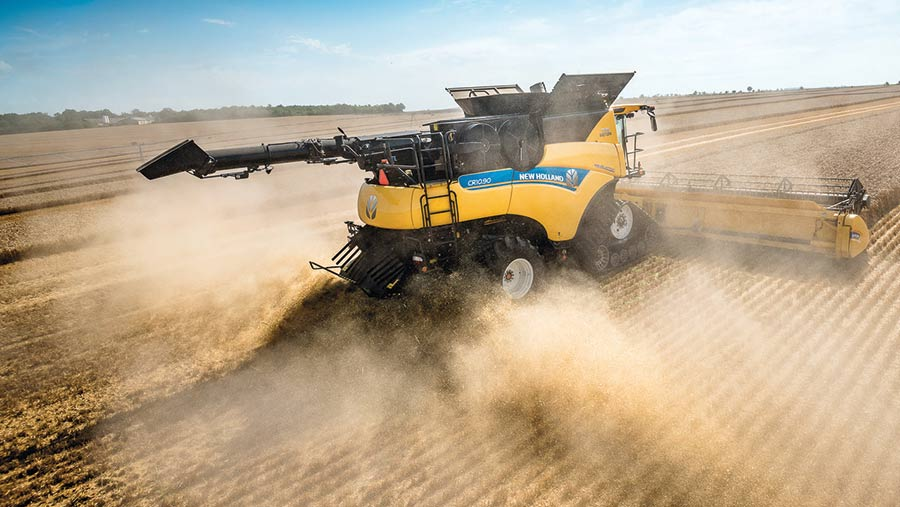 A New Holland CR10 90 Revelation works in a field