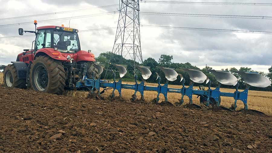 A Case IH Magnum 335 tractor with Lemken plough works in the field