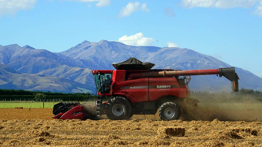 David Clark combining garden peas on the first day of harvest 2017 with Mount Hutt in the background © David Clark