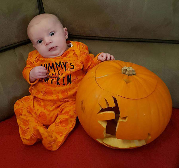 Babay OScar with his John Deere pumpkin