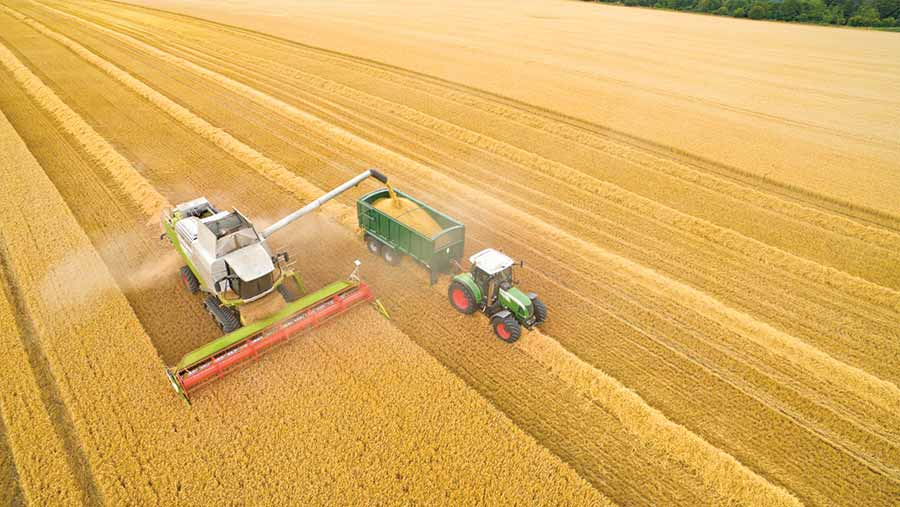 Aerial view of tractor and combine on tramlines