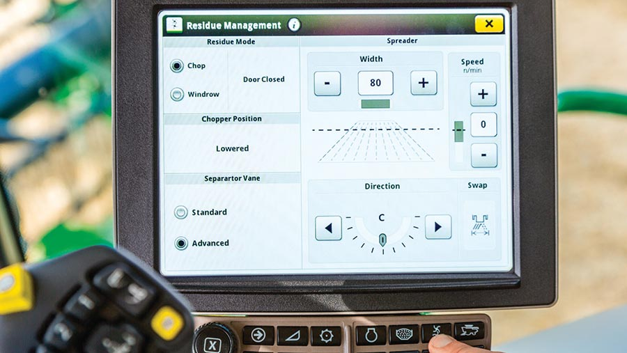 A close-up of the John Deere S700 combine residue management system