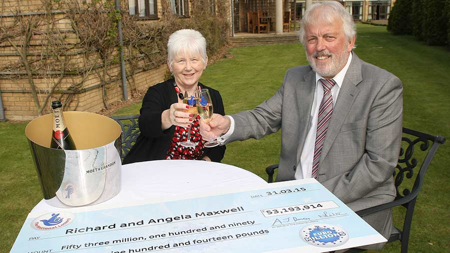 Richard and Angela Maxwell with their lottery win cheque
