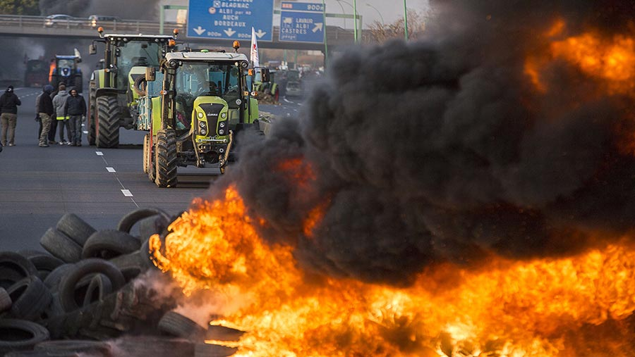 Tractor with fire at Farmer's demonstration, Toulouse