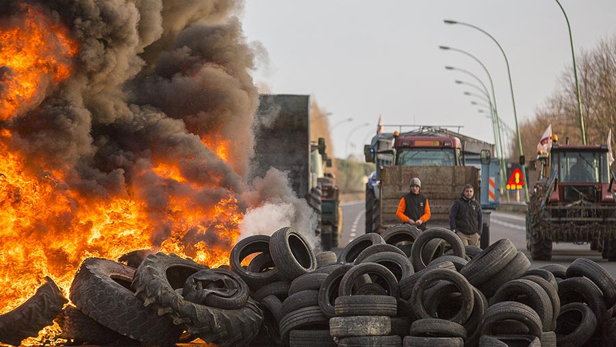 Tires burning in the road during French farmer protest