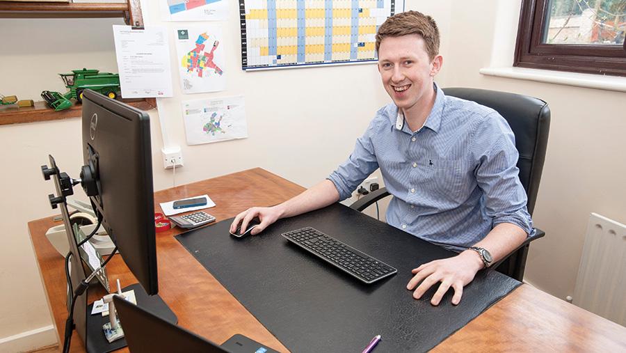 Alistair McBain behind a desk