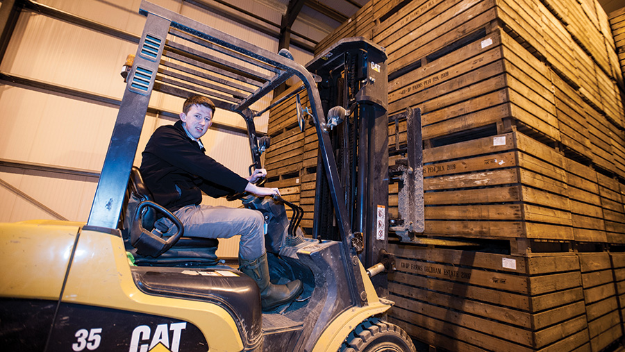 Alistair McBain with a forklift lifting a pallet