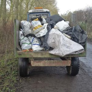 Fly-tipped waste is cleared up