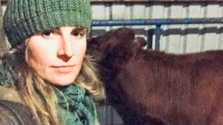 Amanda Owen with a cow