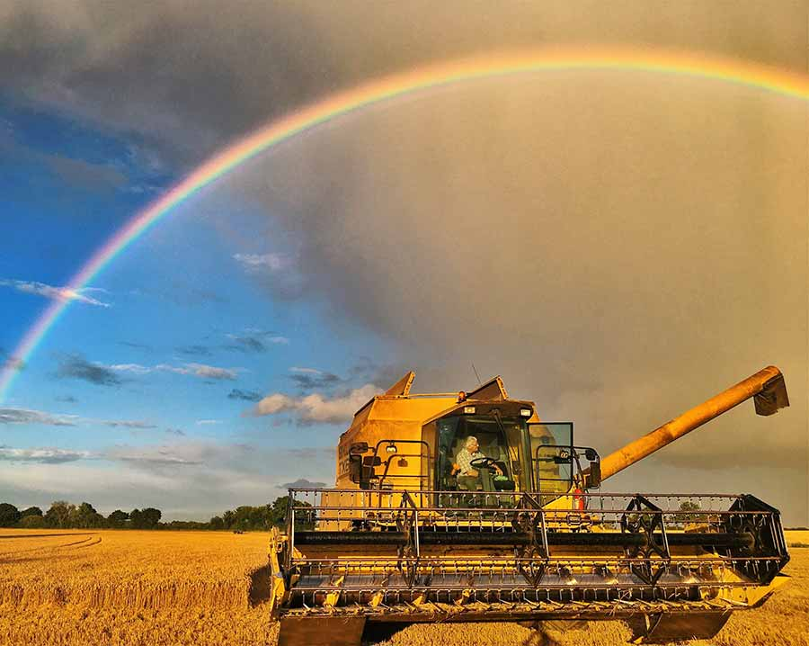 Rainbow over a combine at harvest