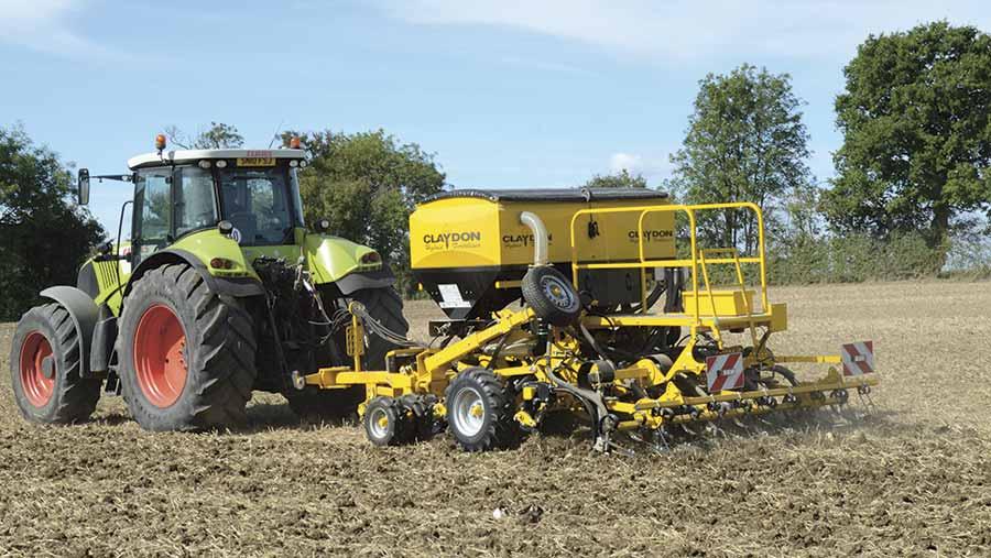 A tractor pulling a claydon hybrid drill