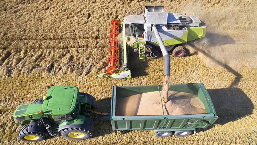 Combine and tractor at harvest