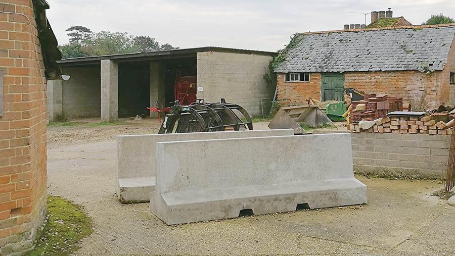 Concrete barriers around farm buildings