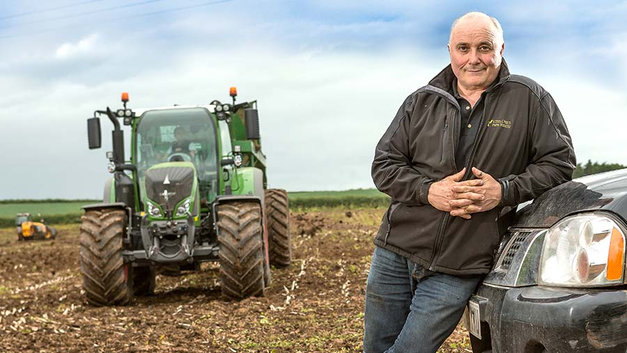 Russell Price in a field with a tractor
