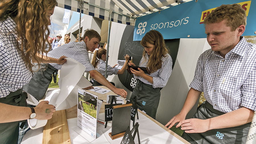 Farmers Weekly contestants on a stall