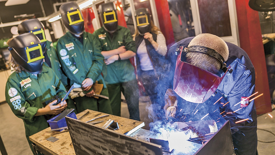 Farmers Apprentice contestants attempt a welding challenge
