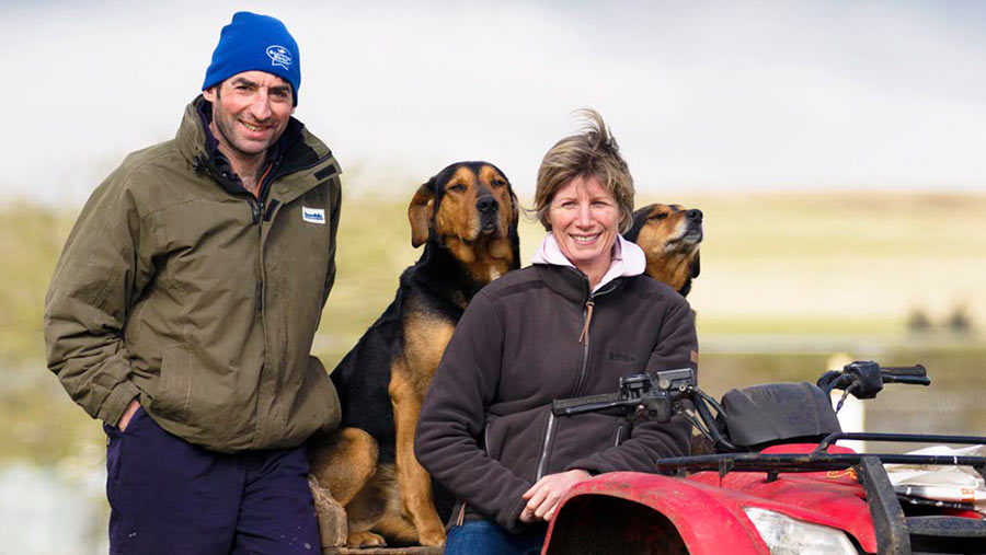 Hamish and Susie Dyke sit on an ATV  with their dogs