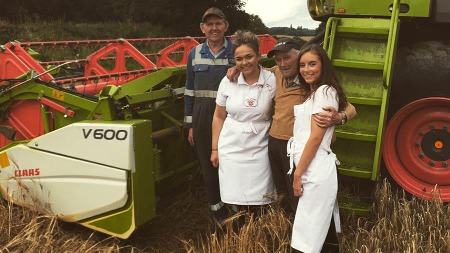 Arthur Widdowson and Francesca Ward next to a combine harvester