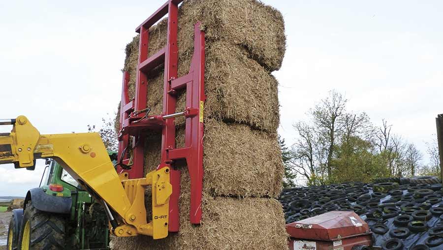 A heath super-bale grab lifting some hay bales
