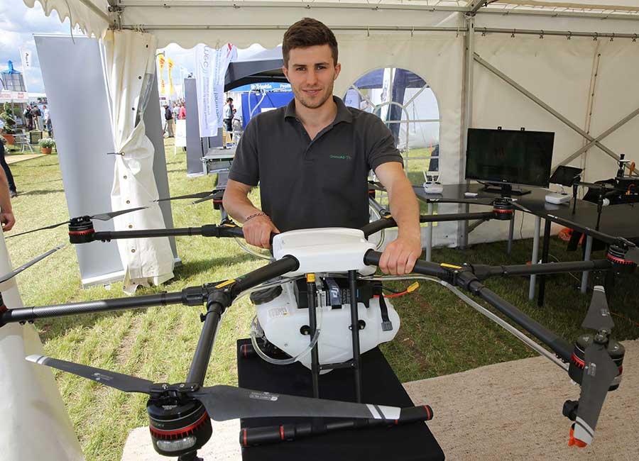 Hugh Wrangham with the sprayer drone © Tim Scrivener